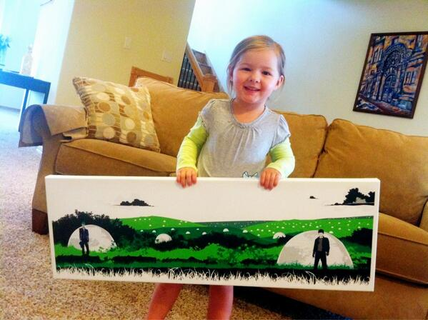 Here is my daughter holding the original canvas artwork for Quentin McFury - The Last Defender!
