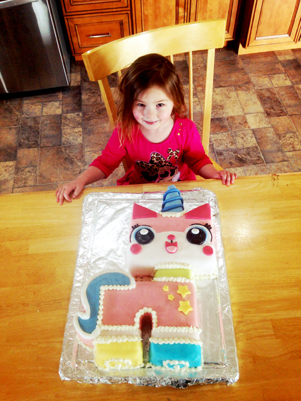 Clara with her Unikitty Cake. Happy Birthday my sweet little girl!