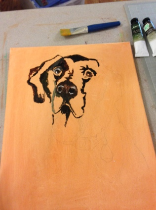 I wash the canvas with burnt sienna, then start blocking out my shadows and detail the eyes and nose.